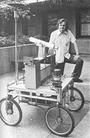 Hans Moravec with the Stanford Cart in 1977. (Image courtesy of Cybernetic Zoo)