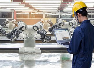 worker with laptop with industry robots