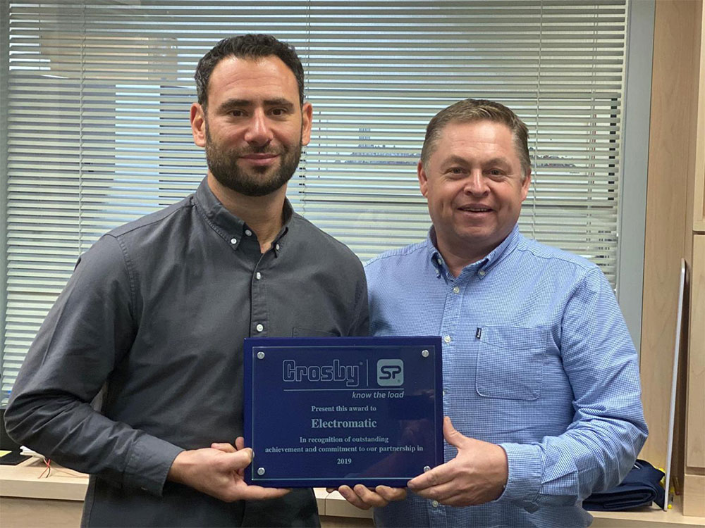 David Ayling (right) was on hand to present Electromatic's Brett Linzer with its award during a pre-scheduled visit.