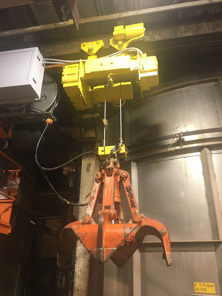 The Wright Work-Rated electric wire rope hoist is installed on a 42.9 ft.-long beam with a 4 ft. radius curve.