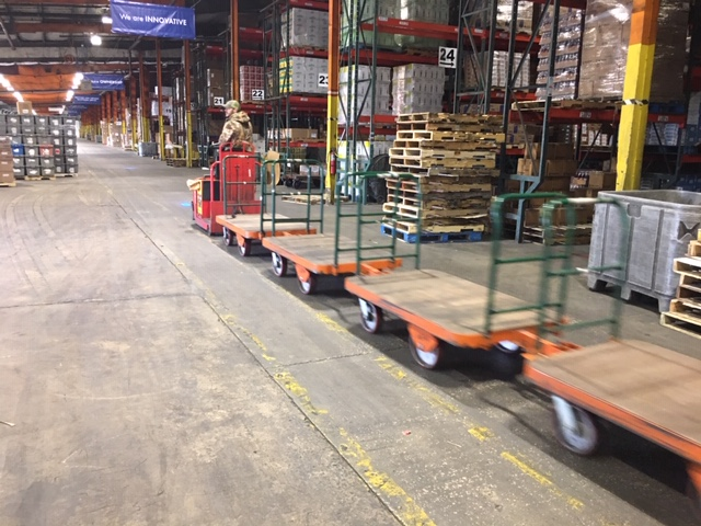 The trailers are utilized behind electric tow tractors with multiple units used to increase picking rates.