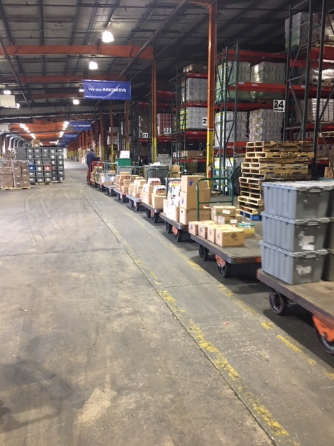 The trailers allow the user to pick four customer orders in one pass thru the warehouse.