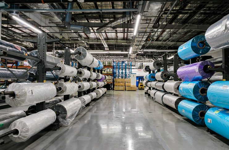 Cantilever racks hold Madico's raw material rolls which keep the rolls clean prior to being laminated together to form a finished product.