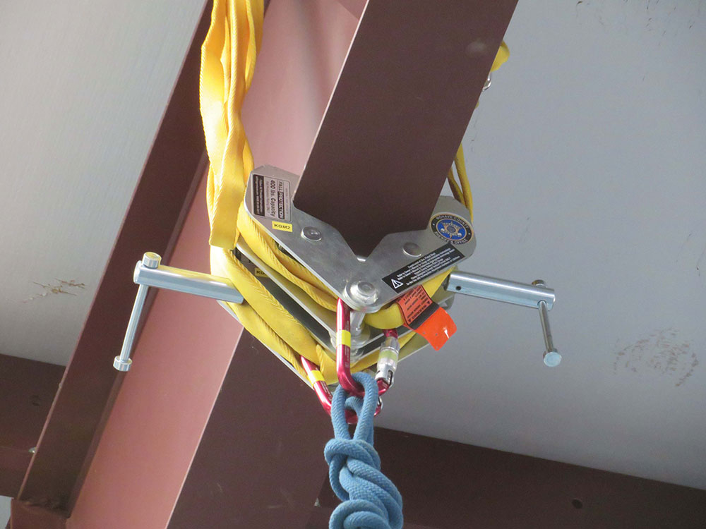 The clamps will be used to support a rappel line from an overhead beam.