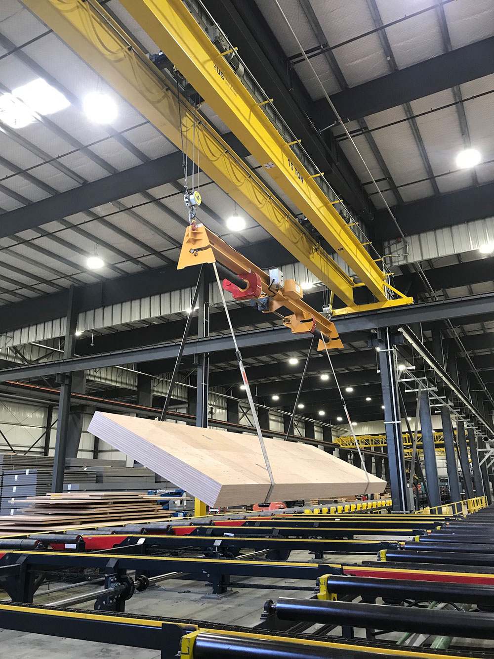 The Posi-Turner is operated beneath the hook of a 15-ton capacity overhead crane.