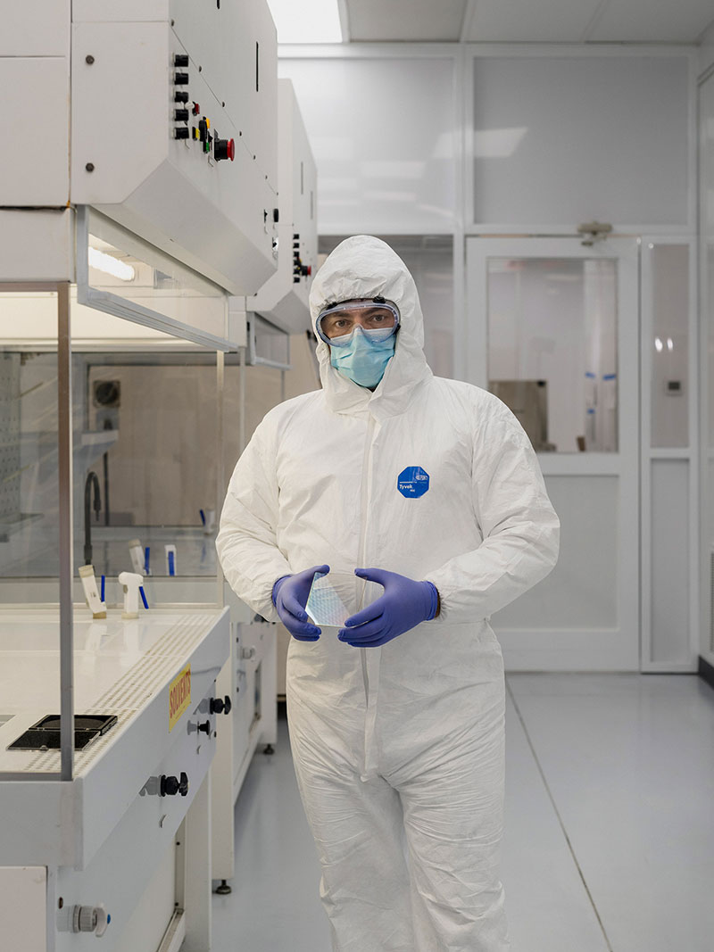 Employees work in a cleanroom environment made up of fresh air, a filtered air system and positive pressure in an enclosed room system.