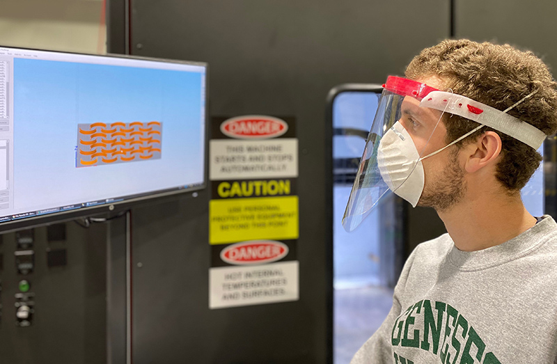 Titan Robotics engineer Anthony Tantillo demonstrates a 3D printed face shield made on the Titan Atlas 3D printer with pellet extrusion.