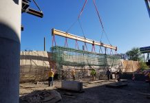 The 75 ft.-long, 50,000-lb. capacity beam is being used for lifting 60 rebar cages.