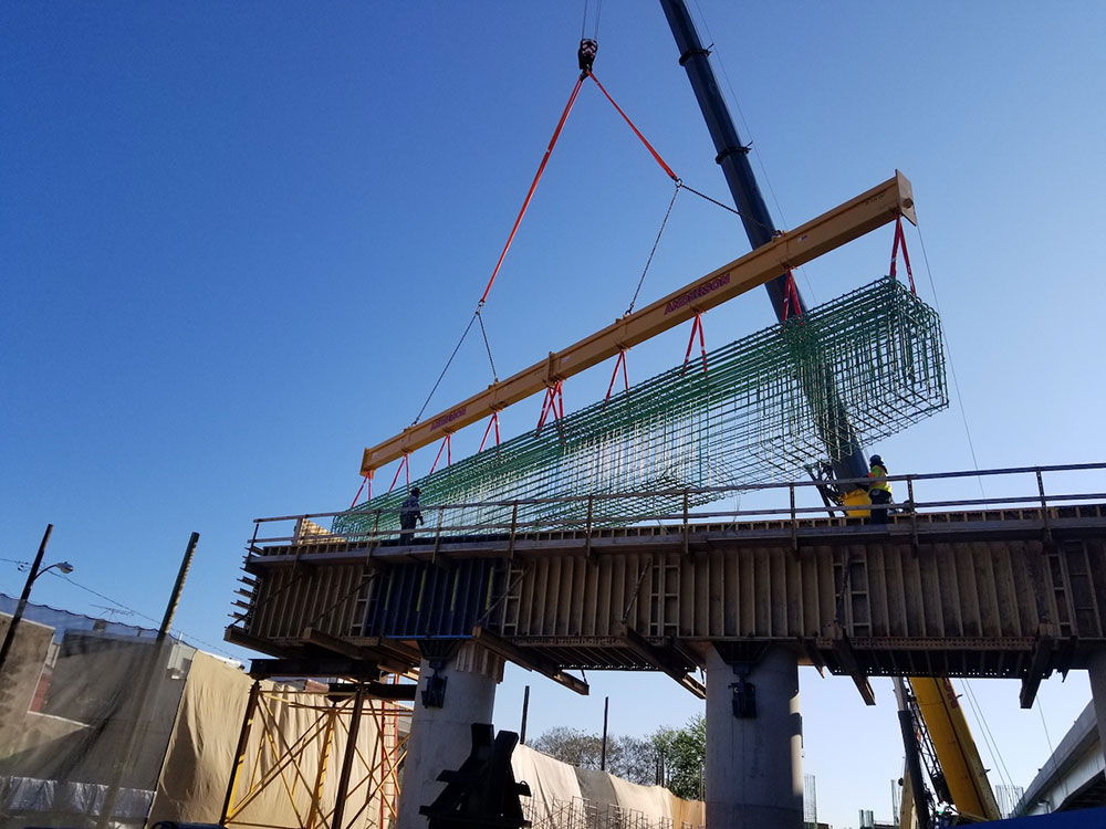 The two-piece beam is currently being used beneath the hook of a 275-ton capacity Grove mobile crane.