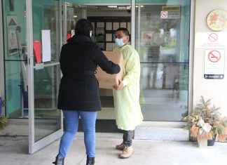 Keter employee delivers donated face shields to a long-term care facility.