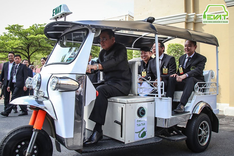 Prime Minister of Thailand, Prayut Chan-o-cha, showcasing an Electric Tuk Tuk vehicle, manufactured in Thailand.