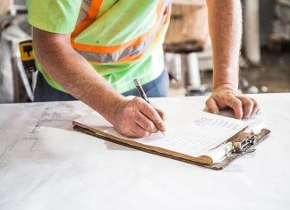 A checklist is reviewed to monitor for OSHA noncompliance.