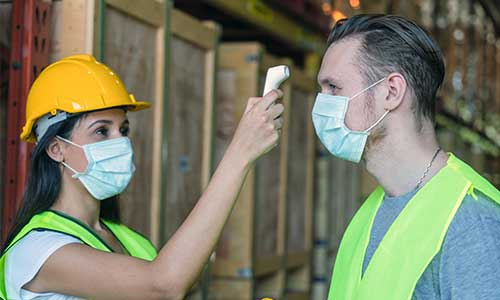 Temperature checks, masks, and onsite visitor guidelines are all potential safety precautions for manufacturers during COVID-19.