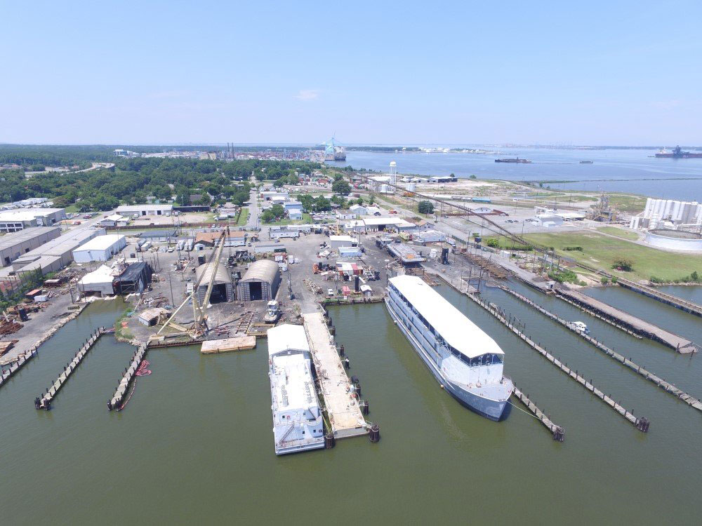 Eastern view of Pier 14, showing groups of new plumb piles and floating crane.
