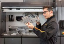 A technician inspects a part from one of HPs MultiJet Fusion printers. HP is one of the largest existing companies to enter the space.
