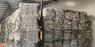 Recyclables wait to be processed in a warehouse.