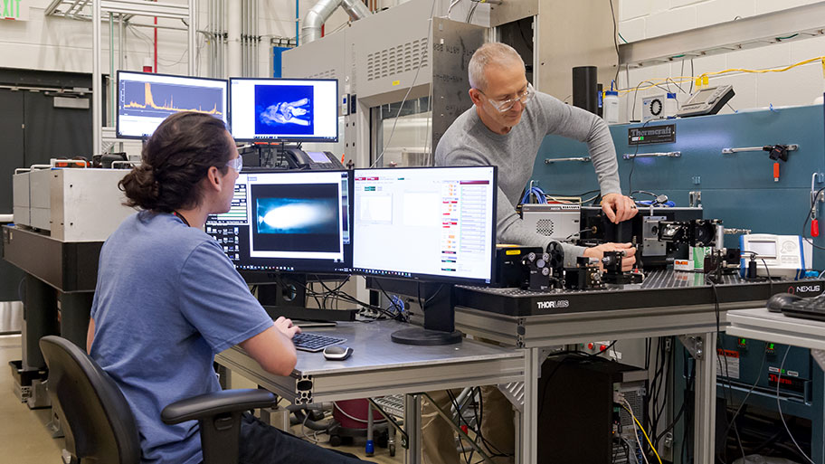 Joseph Libera and Anthony Stark prepare for in-situ Raman spectroscopy. (Image by Argonne National Laboratory.)