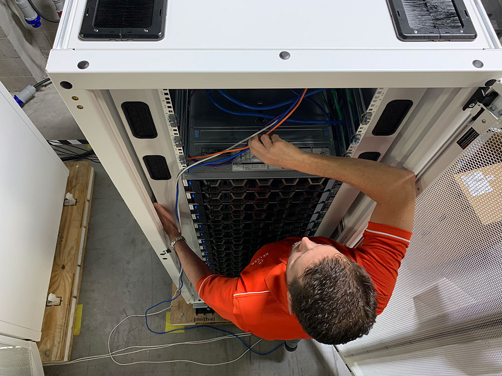 Kelser Systems Engineer Rob Backus customizes IT hardware. Upgrades needed to comply with NIST 800-171 and CMMC vary for each manufacturer.
