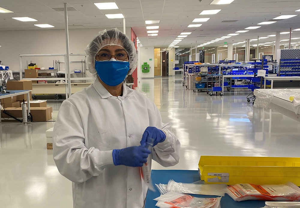 Marta Kolar, Earn and Learn Pilot Program participant, learns about biomedical manufacturing on the job.