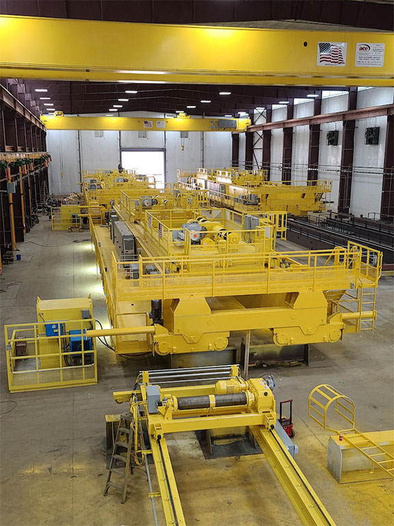 The new site features high-capacity overhead cranes, a 280-ft. girder table and automated gantry welder.
