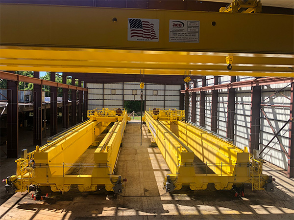 250/25 ton overhead cranes used in the aerospace industry. These two cranes have a span of 201 ft. each.