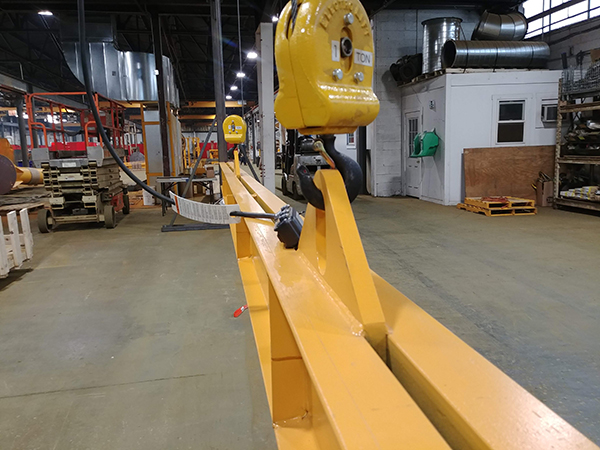 The centerpiece of the installation was a 1-ton capacity twin-hook Caldwell lifting beam.