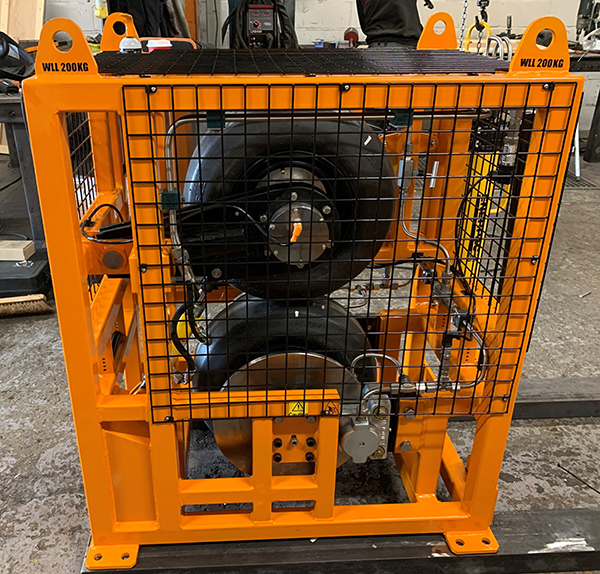The tyres are connected to a hydraulic cylinder to clamp the wheels together.