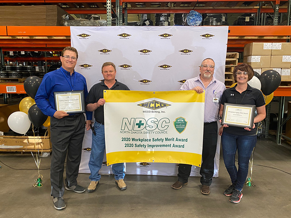 (From left to right) Tom Shorma, Dewey Miller, Rod Koch and Stefani Mikkelson accepted two awards from the North Dakota Safety Council at a ceremony.