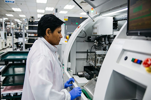 A Flex employee working on an advanced manufacturing line