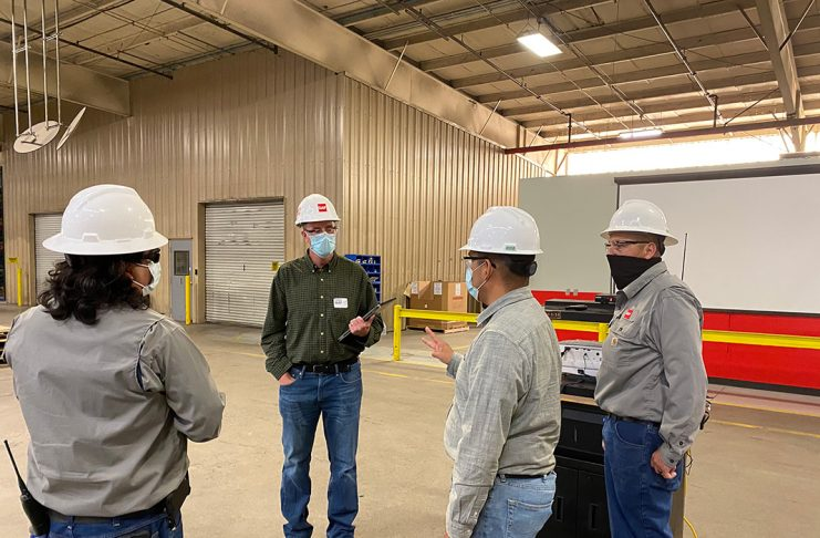 Randy Bargfrede, COO of GAF, speaks with plant team members at the company's Fontana, CA location.